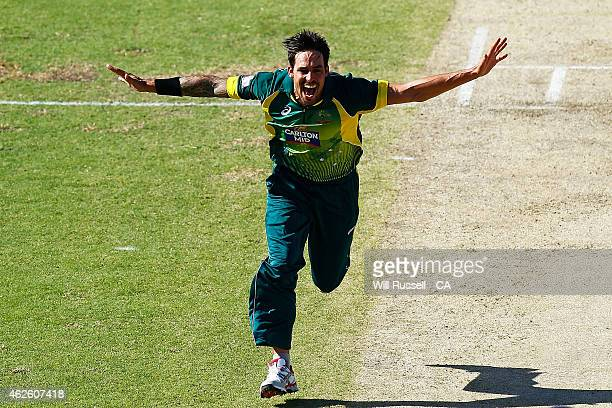 Mitchell Johnson of Australia celebrates after taking the wicket of James Taylor of England during the final match of the Carlton Mid One Day...