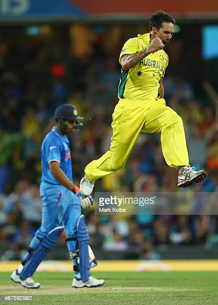 Mitchell Johnson of Australia celebrates after taking the wicket of Rohit Sharma of India during the 2015 Cricket World Cup Semi Final match between...