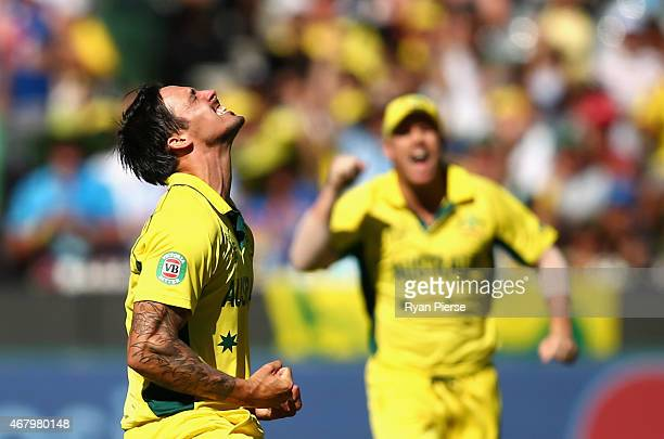 Mitchell Johnson of Australia celebrates after taking the wicket of Kane Williamson of New Zealand during the 2015 ICC Cricket World Cup final match...