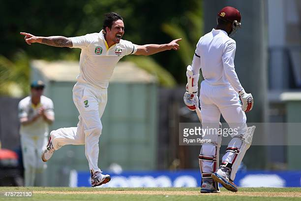 Mitchell Johnson of Australia celebrates after taking the wicket of Shai Hope of West Indies during day one of the First Test match between Australia...