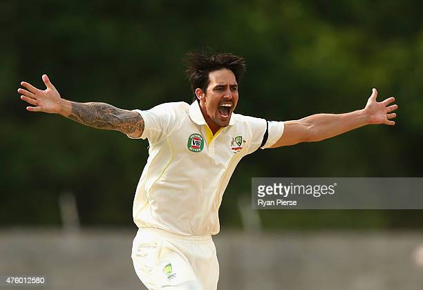 Mitchell Johnson of Australia celebrates after taking the wicket of Marlon Samuels of West Indies during day three of the First Test match between...