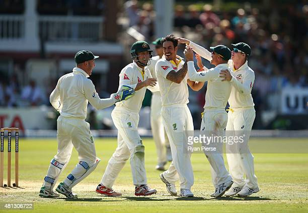 Mitchell Johnson of Australia celebrates after taking the wicket of Jos Buttler of England during day four of the 2nd Investec Ashes Test match...