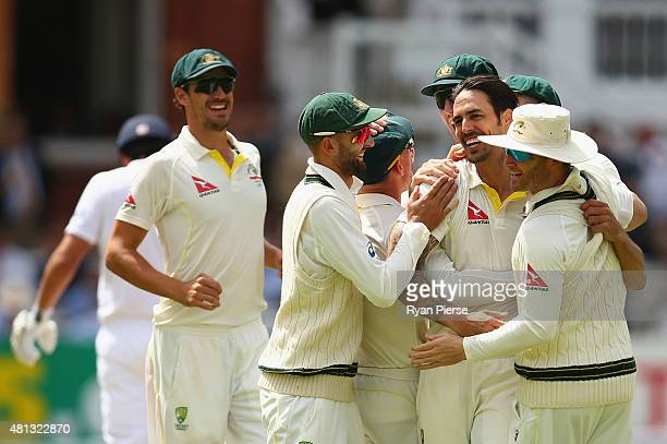 Mitchell Johnson of Australia celebrates after taking the wicket of Alastair Cook of England during day four of the 2nd Investec Ashes Test match...