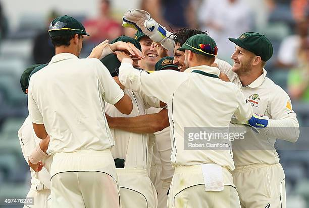 Mitchell Johnson of Australia celebrates after taking the wicket of Martin Guptill of New Zealand during day five of the second Test match between...