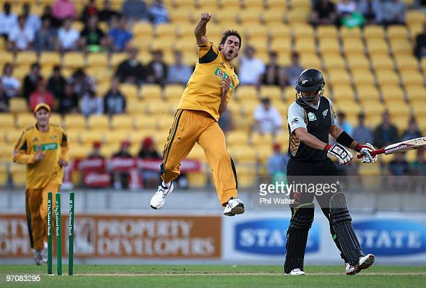Mitchell Johnson of Australia celebrates bowling Peter Ingram of New Zealand during the Twenty20 international match between New Zealand and...