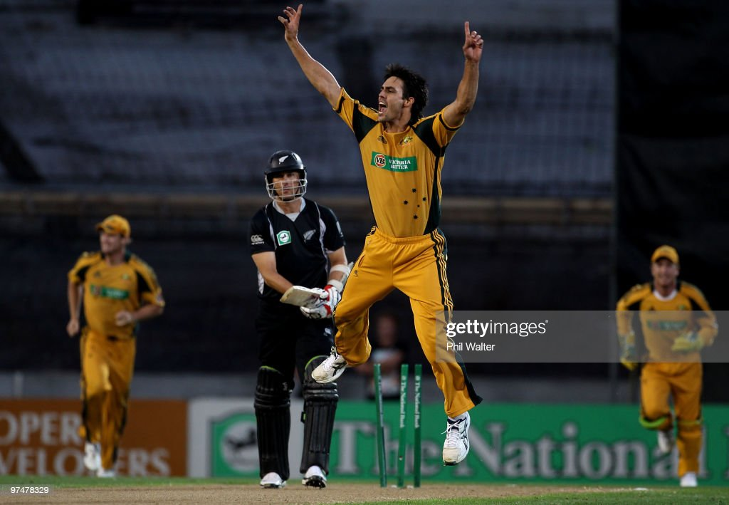 Mitchell Johnson of Australia celebrates bowling Shane Bond of New Zealand during the Second One Day International match between New Zealand and Australia at Eden Park on March 6, 2010 in Auckland, New Zealand.