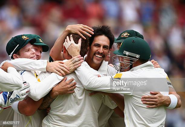Mitchell Johnson of Australia celebrates celebrates after taking the wicket of Alastair Cook of England during day four of the Second Ashes Test...