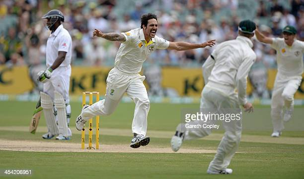 Mitchell Johnson of Australia celebrates dismissing England captain Alastair Cook during day four of the Second Ashes Test Match between Australia...