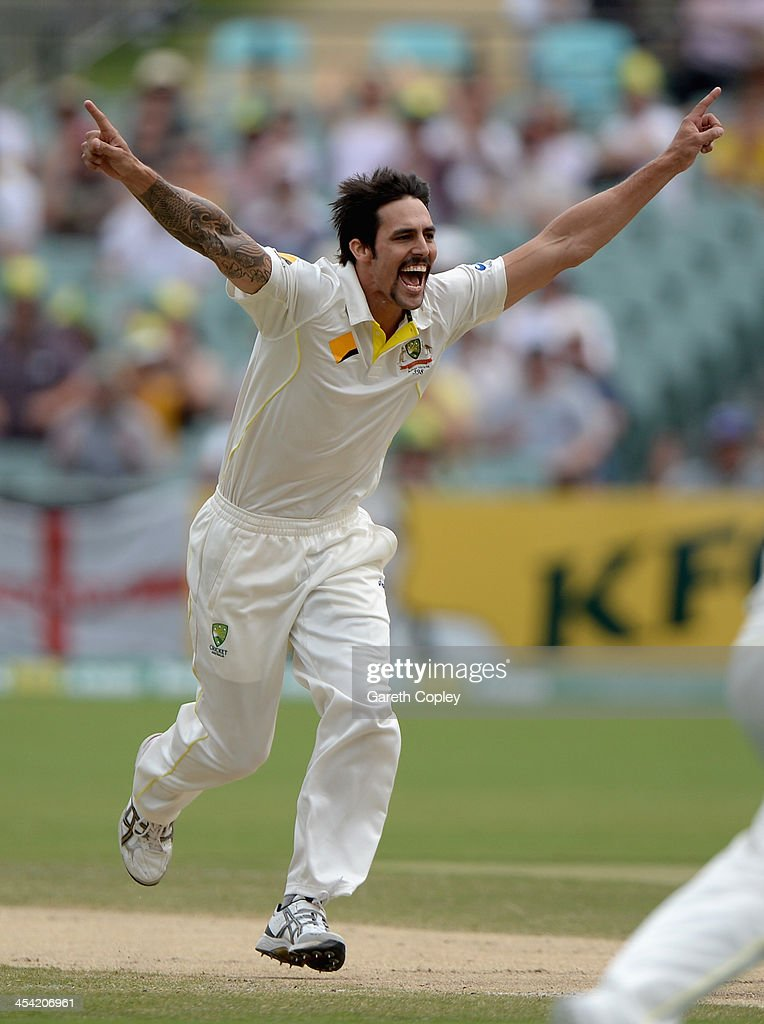 Mitchell Johnson of Australia celebrates dismissing England captain Alastair Cook during day four of the Second Ashes Test Match between Australia and England at Adelaide Oval on December 8, 2013 in Adelaide, Australia.