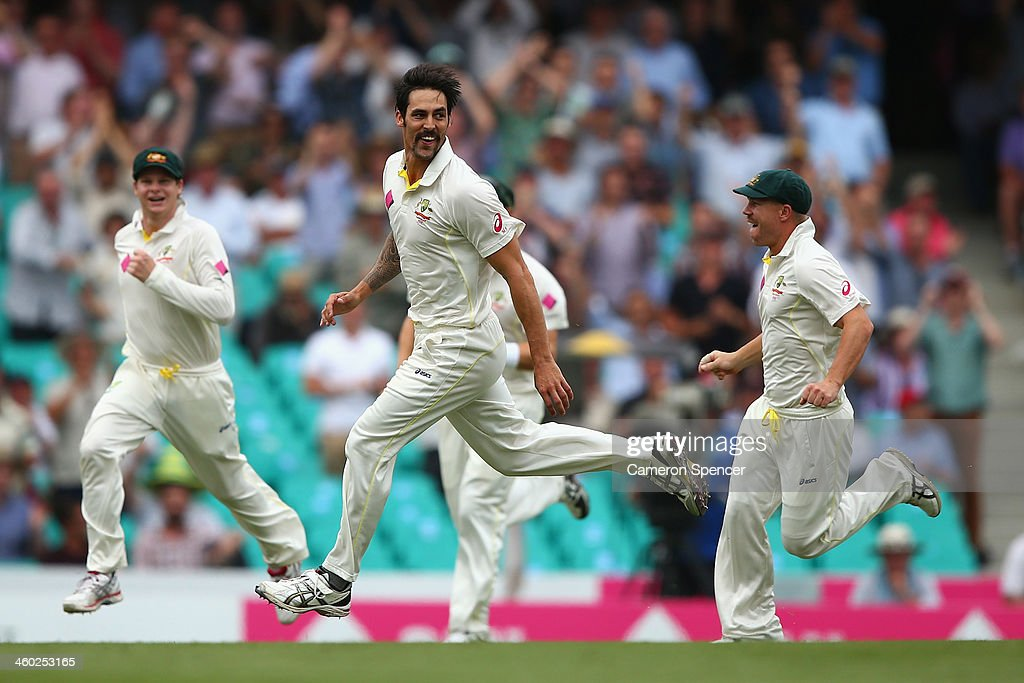 Mitchell Johnson of Australia celebrates dismissing Michael Carberry of England during day one of the Fifth Ashes Test match between Australia and England at Sydney Cricket Ground on January 3, 2014 in Sydney, Australia.
