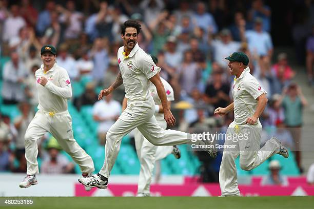 Mitchell Johnson of Australia celebrates dismissing Michael Carberry of England during day one of the Fifth Ashes Test match between Australia and...