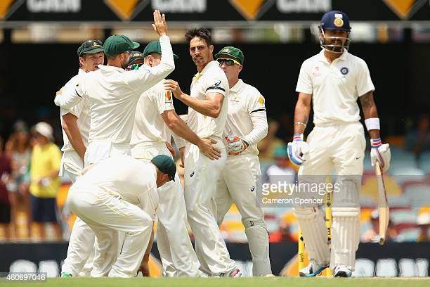 Mitchell Johnson of Australia celebrates dismissing Virat Kohli of India during day four of the 2nd Test match between Australia and India at The...