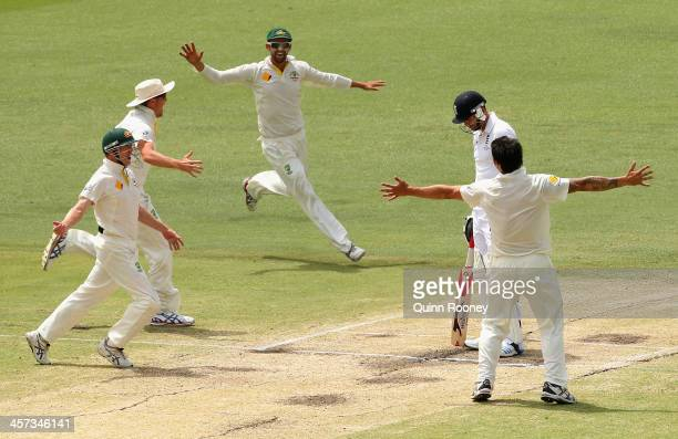 Mitchell Johnson of Australia celebrates getting the final wicket of James Anderson of England to win the match and the Ashes during day five of the...