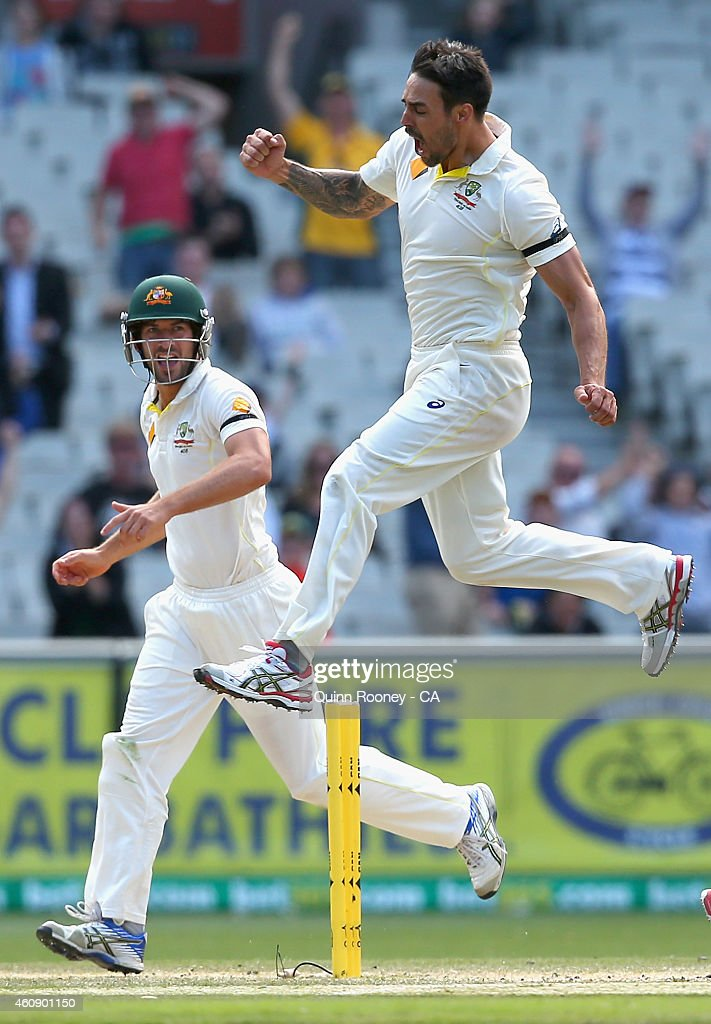 Mitchell Johnson of Australia celebrates getting the wicket of Cheteshwar Pujara of India during day five of the Third Test match between Australia and India at Melbourne Cricket Ground on December 30, 2014 in Melbourne, Australia.