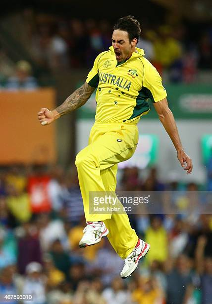 Mitchell Johnson of Australia celebrates getting the wicket of Rohit Sharma of India during the 2015 Cricket World Cup Semi Final match between...