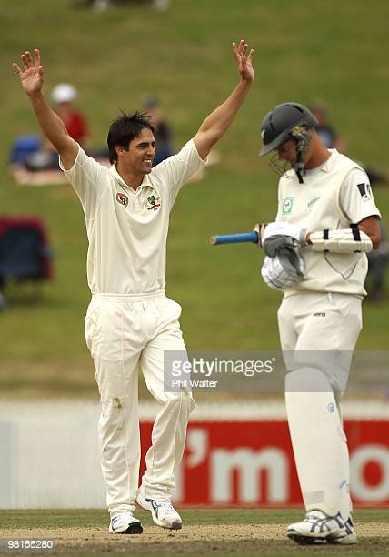 Mitchell Johnson of Australia celebrates his 6th wicket of Tim Southee of New Zealand to win the match as Chris Martin looks on during day five of...