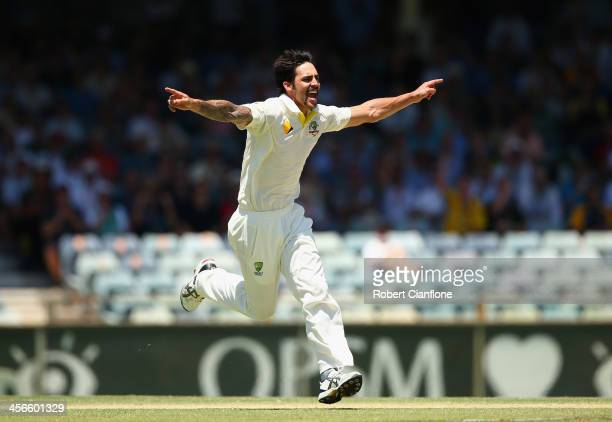 Mitchell Johnson of Australia celebrates taking the wicket of Ben Stokes of England during day three of the Third Ashes Test Match between Australia...