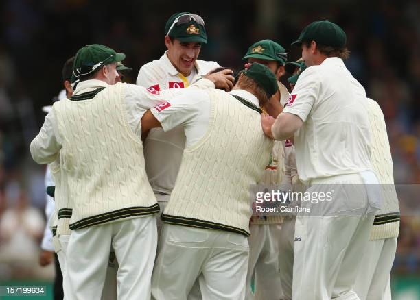 Mitchell Johnson of Australia celebrates taking the wicket of Dean Elgar of South Africa during day one of the Third Test Match between Australia and...