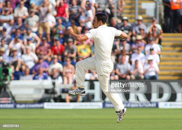 Mitchell Johnson of Australia celebrates taking the wicket of Ian Bell of England during day three of the 1st Investec Ashes Test match between...