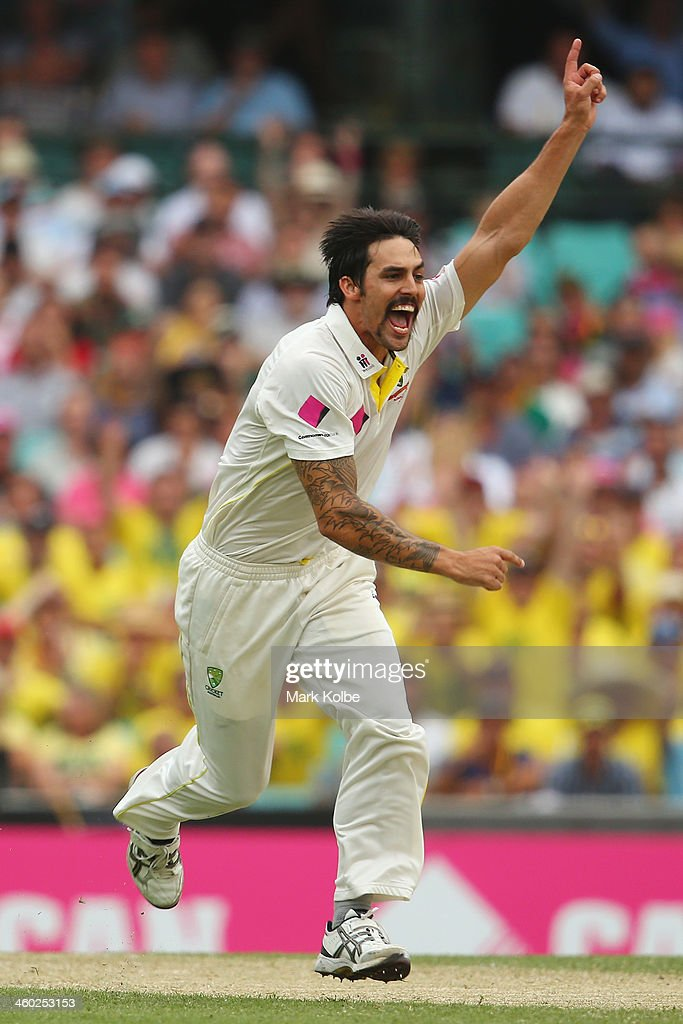 Mitchell Johnson of Australia celebrates taking the wicket of Michael Carberry of England during day one of the Fifth Ashes Test match between Australia and England at Sydney Cricket Ground on January 3, 2014 in Sydney, Australia.