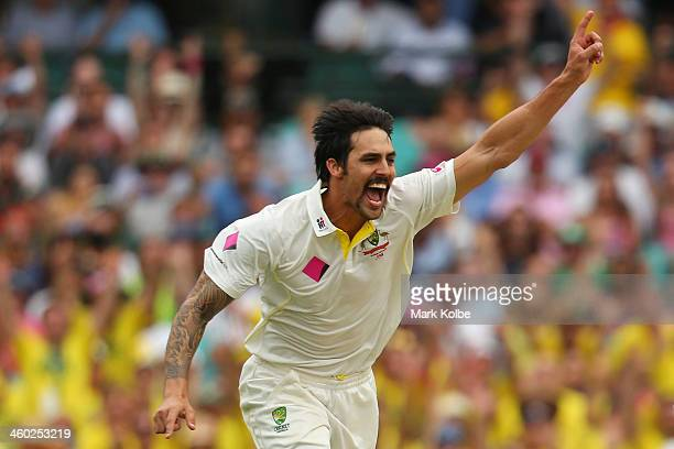 Mitchell Johnson of Australia celebrates taking the wicket of Michael Carberry of England during day one of the Fifth Ashes Test match between...