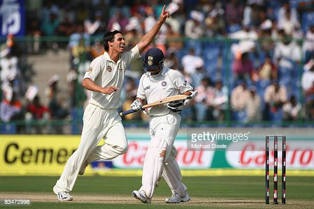 Mitchell Johnson of Australia celebrates taking the wicket of Sachin Tendulkar during day one of the Third Test match between India and Australia at...