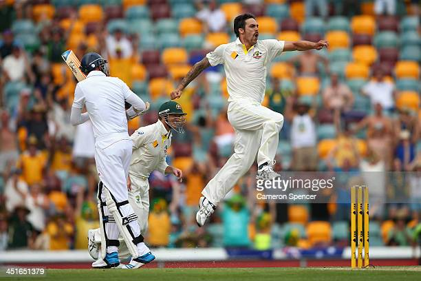 Mitchell Johnson of Australia celebrates taking the wicket of Stuart Broad of England during day four of the First Ashes Test match between Australia...
