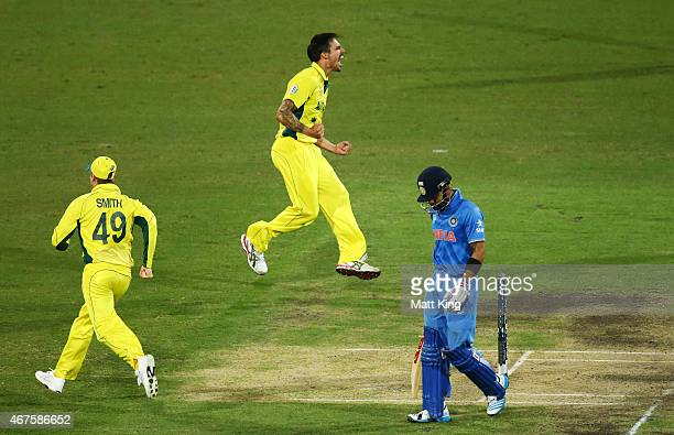 Mitchell Johnson of Australia celebrates taking the wicket of Virat Kohli of India during the 2015 Cricket World Cup Semi Final match between...