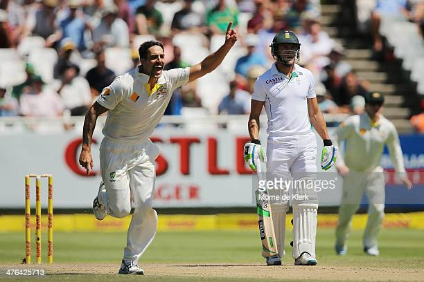 Mitchell Johnson of Australia celebrates the wicket of AB de Villiers of South Africa during day 3 of the third test match between South Africa and...