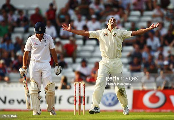 Mitchell Johnson of Australia celebrates the wicket of Alastair Cook of England during day two of the npower 4th Ashes Test Match between England and...