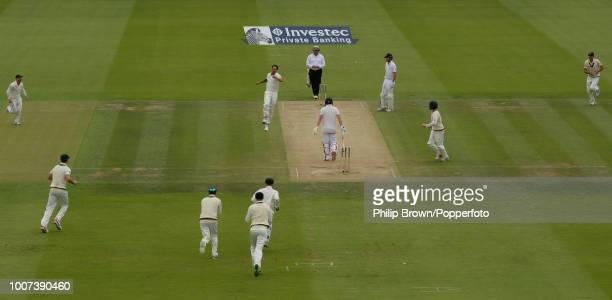 Mitchell Johnson of Australia celebrates the wicket of England batsman Gary Ballance bowled for 23 runs during the 2nd Ashes Test match between...