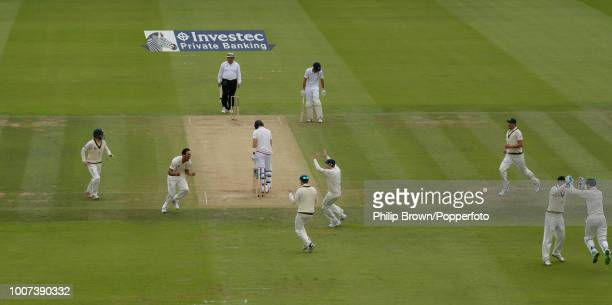 Mitchell Johnson of Australia celebrates the wicket of England batsman Joe Root for 1 run during the 2nd Ashes Test match between England and...