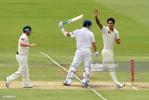 Mitchell Johnson of Australia celebrates the wicket of Graeme Swann of England during day four of the Third Ashes Test match between Australia and...
