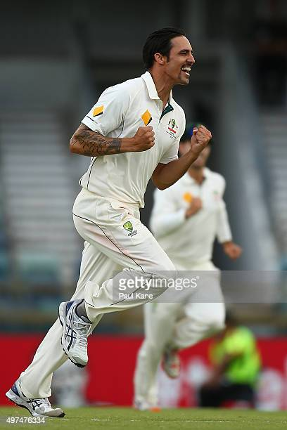 Mitchell Johnson of Australia celebrates the wicket of Tom Latham of New Zealand during day five of the second Test match between Australia and New...