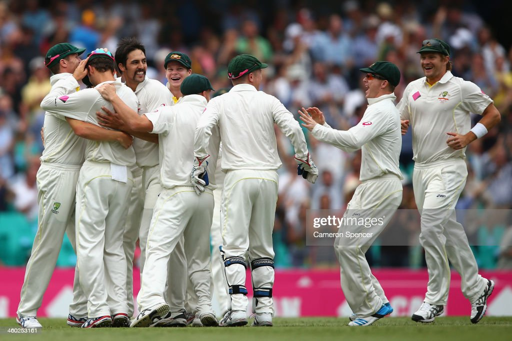 Mitchell Johnson of Australia celebrates with team mates after dismissing Michael Carberry of England during day one of the Fifth Ashes Test match between Australia and England at Sydney Cricket Ground on January 3, 2014 in Sydney, Australia.