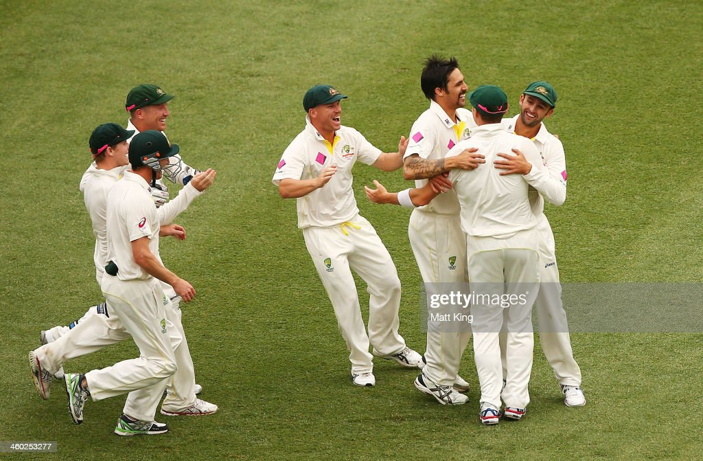 Mitchell Johnson of Australia celebrates with team mates after taking the wicket of Michael Carberry of England during day one of the Fifth Ashes Test match between Australia and England at Sydney Cricket Ground on January 3, 2014 in Sydney, Australia.