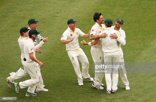Mitchell Johnson of Australia celebrates with team mates after taking the wicket of Michael Carberry of England during day one of the Fifth Ashes...
