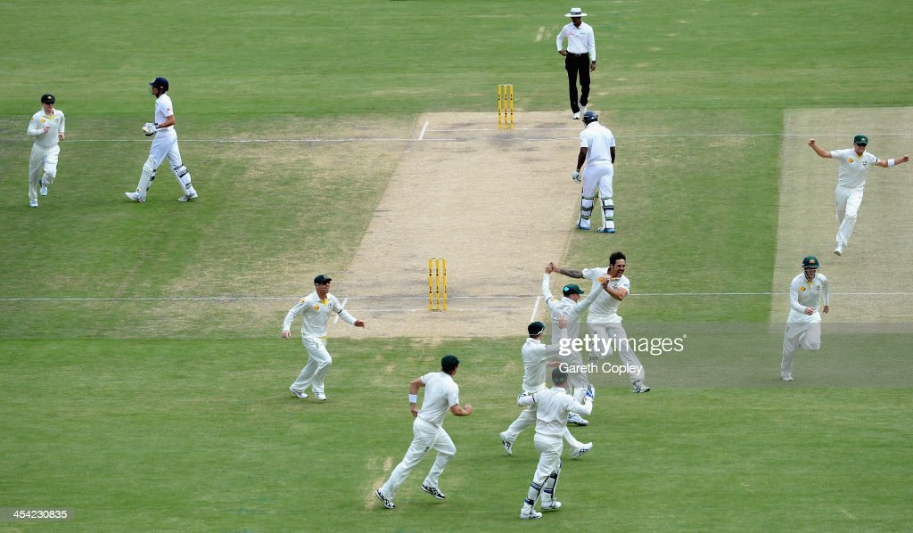 Mitchell Johnson of Australia celebrates with teammates after dismissing England captain Alastair Cook during day four of the Second Ashes Test Match between Australia and England at Adelaide Oval on December 8, 2013 in Adelaide, Australia.