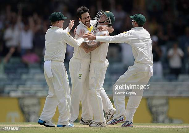 Mitchell Johnson of Australia celebrates with teammates after taking the final wicket of James Anderson of England to win the Third Ashes Test Match...