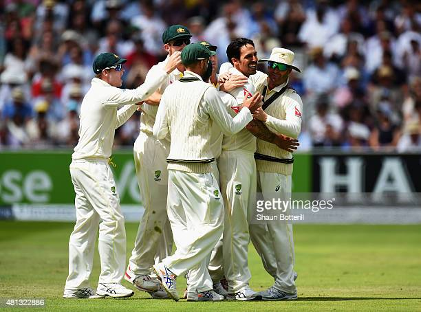 Mitchell Johnson of Australia celebrates with teammates after taking the wicket of Alastair Cook of England during day four of the 2nd Investec Ashes...