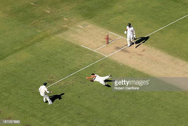 Mitchell Johnson of Australia dives to take the catch of Alviro Petersen of South Africa during day two of the Third Test Match between Australia and...