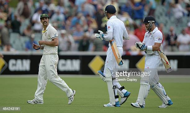 Mitchell Johnson of Australia exchanges words with Stuart Broad and Matt Prior of England as they leave the field at the end of day four of the...