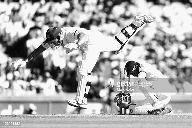 Mitchell Johnson of Australia falls after colliding with Dinesh Chandimal of Sri Lanka during day two of the Third Test match between Australia and...