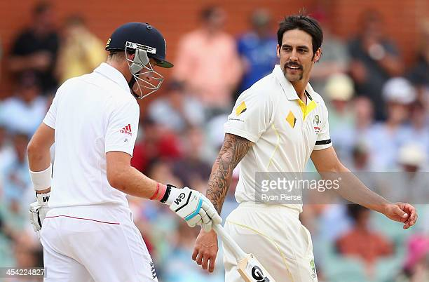 Mitchell Johnson of Australia has words with Joe Root of England during day four of the Second Ashes Test Match between Australia and England at...