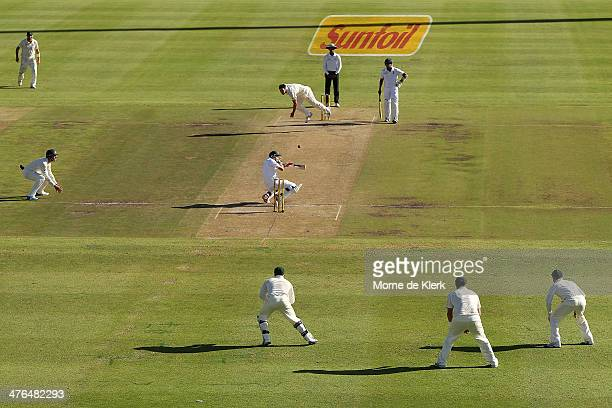 Mitchell Johnson of Australia hits Dale Steyn of South Africa on the helmet with a short delivery during day 3 of the third test match between South...