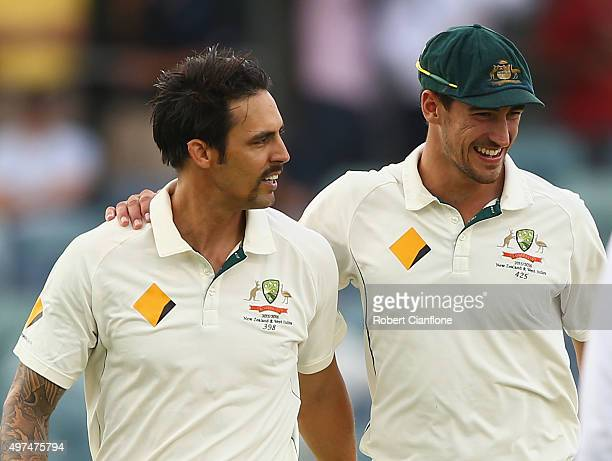 Mitchell Johnson of Australia is acknowledged by Mitchell Starc as he prepares to bowl during day five of the second Test match between Australia and...