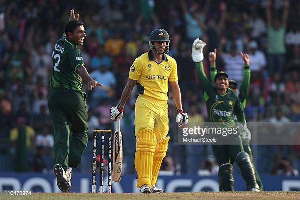 Mitchell Johnson of Australia is caught by wicketkeeper Kamran Akmal off the bowling of Abdul Razzaq during the 2011 ICC World Cup Group A match...