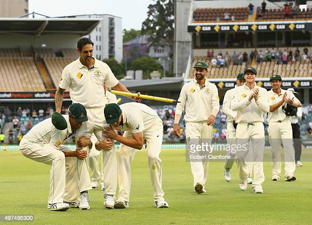Mitchell Johnson of Australia is chaired off by team mates after he announced hi retirement during day five of the second Test match between...