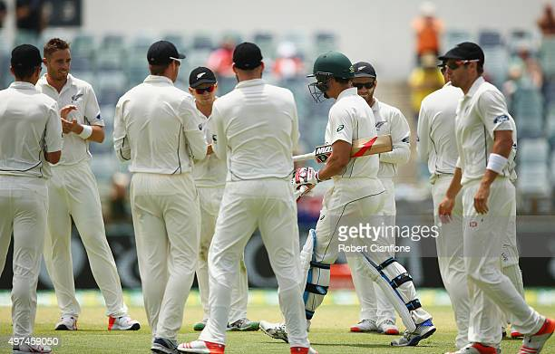 Mitchell Johnson of Australia is given a guard of honour by players from New Zealand during day five of the second Test match between Australia and...