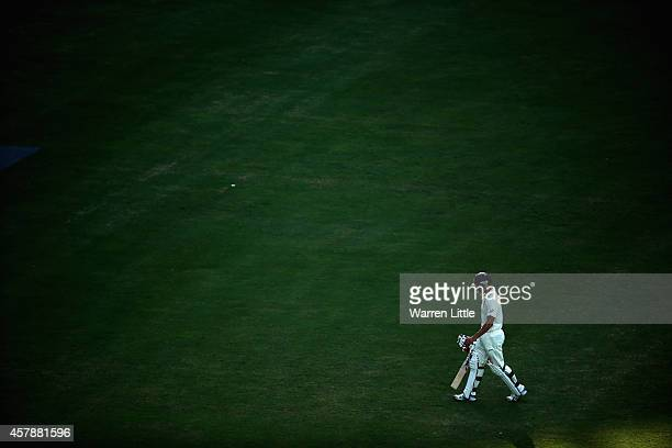 Mitchell Johnson of Australia leaves the pitch dismissed by Yasir Shah of Pakistan during day five of the first test between Pakistan and Australia...